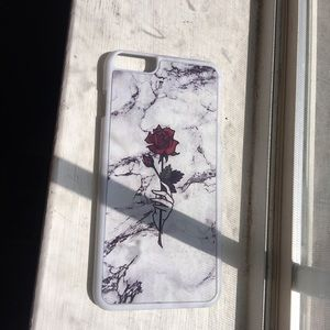 I am selling this Cute Rose IPhone 6s Plus Case